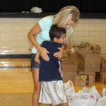 Getting a hug from your teacher makes saying good bye to summer vacation a little easier.